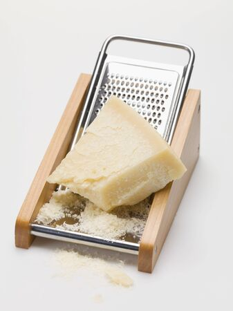 cheese grater: Parmesan on cheese grater LANG_EVOIMAGES