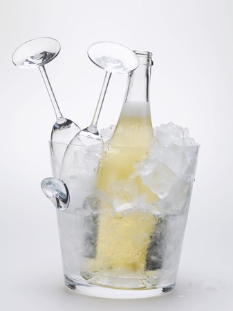 champers: Bottle of sparkling wine & two empty wine glasses in ice bucket