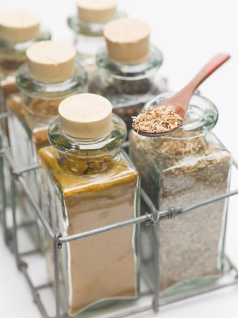 glass bottles: Various spices in small glass bottles and on spoon LANG_EVOIMAGES
