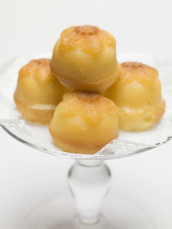 rum baba: Rum babas on glass cake stand