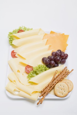 nibbles: Cheese platter with grapes and nibbles