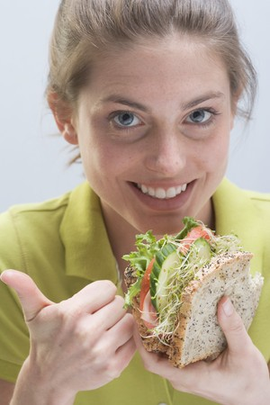 well beings: Smiling woman with sandwich