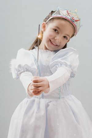 childs birthday party: Little girl dressed as princess holding a sparkler
