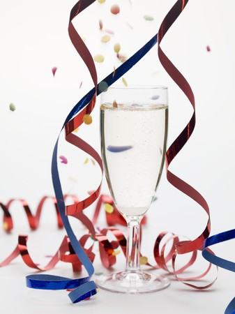champers: Glass of sparkling wine with party decorations