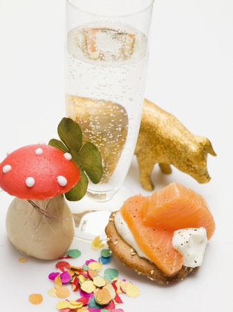 champers: Glass of sparkling wine, salmon appetiser and lucky charms