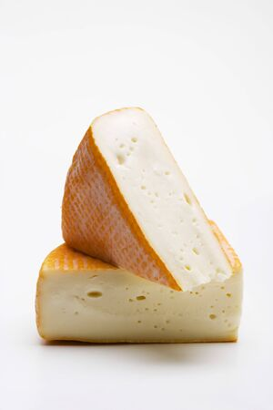 in twos: Two pieces of washed-rind cheese LANG_EVOIMAGES