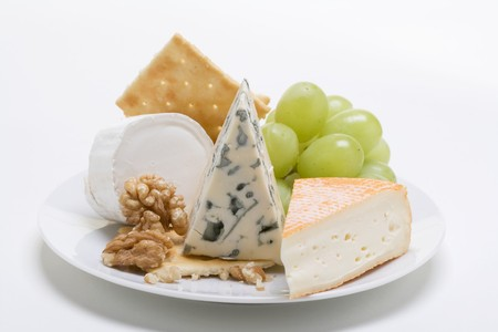 cheese plate: Cheese plate with crackers, nuts and grapes