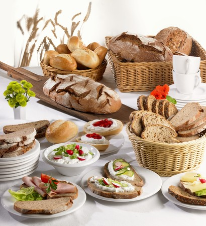 several breads: Open sandwiches and bread products for breakfast
