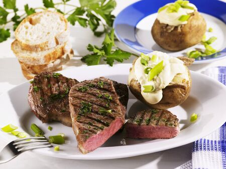 rumpsteak: Grilled rump steak with baked potato and sour cream LANG_EVOIMAGES