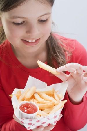 waist deep: Girl eating a bag of chips