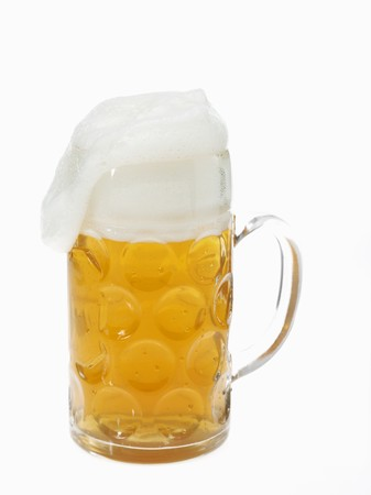 litre: Beer in litre tankard with overflowing foam LANG_EVOIMAGES