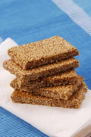 brittle: Five bars of sesame brittle, stacked, on napkin LANG_EVOIMAGES