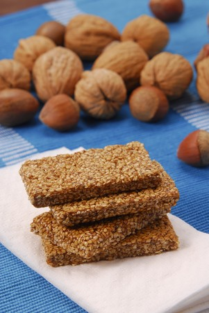 brittle: A few bars of sesame brittle, nuts in background LANG_EVOIMAGES
