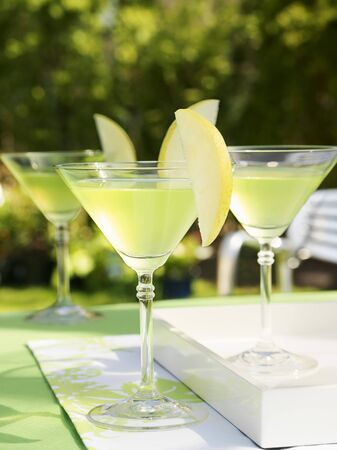 pip: Apple Martinis on table out of doors
