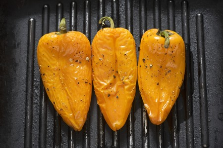 sweet course: Three yellow peppers in a grill frying pan