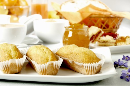 baked  goods: Baked goods, jam and cappuccino for breakfast LANG_EVOIMAGES