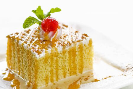 tres: Piece of Tres Leches Cake (cake soaked in milk, Mexico)