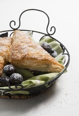 danish puff pastry: Turnovers with Powdered Sugar and Figs in Metal Basket