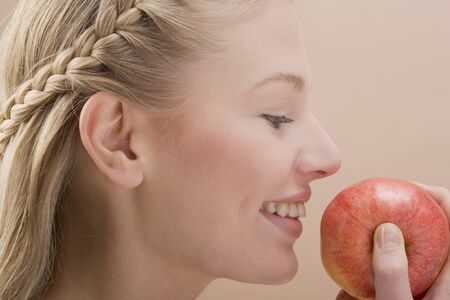 25 to 30 year olds: Woman holding red apple