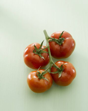 entire: Four tomatoes on the vine