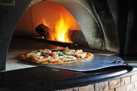 pizza oven: Seafood pizza in stone oven LANG_EVOIMAGES