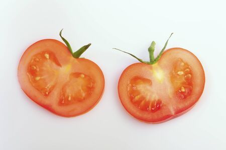 calyxes: Two slices of tomato with calyxes