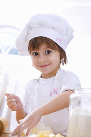 Little girl mixing pastry ingredients