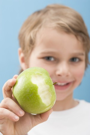 partly: Little boy holding a partly eaten apple LANG_EVOIMAGES