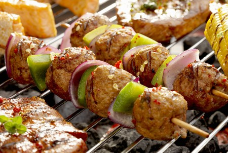 qs: Meat, onion and pepper kebabs on barbecue