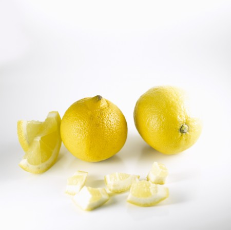 twos: Two lemons and pieces of lemon