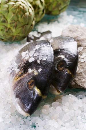 sea bream: Sea bream with sea salt and artichokes