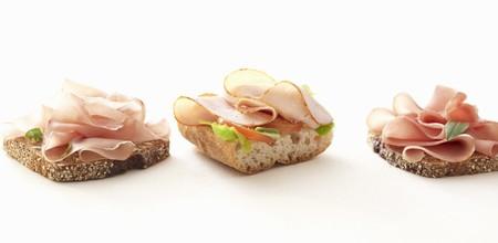 several breads: Three ham open sandwiches