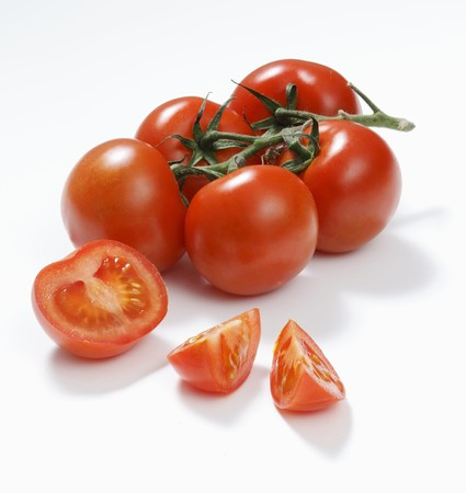 entire: Tomatoes, one cut into pieces