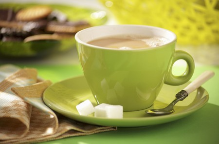 hot coffees: Milky coffee in green cup and saucer