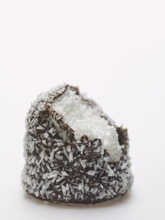teacake: Chocolate teacake covered in grated coconut, a bite taken