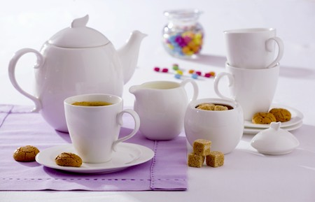 brownness: A cup of tea, amaretti, brown sugar and teapot