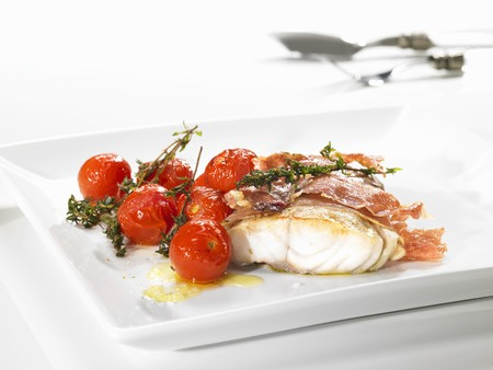 casings: Coalfish wrapped in ham and cherry tomatoes
