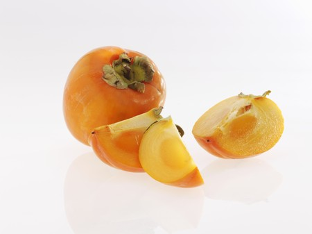 persimmons: Persimmons, whole and sliced