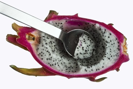 dragonfruit: Half a dragonfruit with a spoon LANG_EVOIMAGES