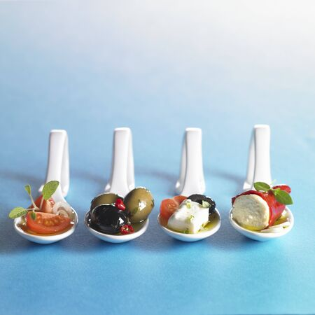amuse: Various antipasti on spoons LANG_EVOIMAGES