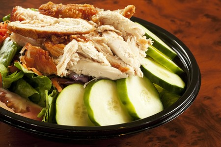 take out: Fried Chicken Salad in Take Out Container LANG_EVOIMAGES