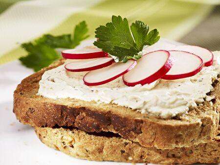 food: Cream cheese and radishes on toast