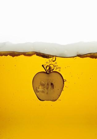 amaretto: Amaretto with a slice of apple