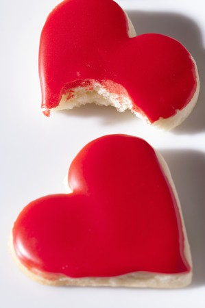 partly: Red heart-shaped biscuits, whole and partly eaten LANG_EVOIMAGES