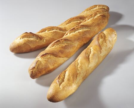 several breads: Three baguettes