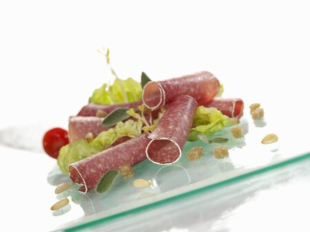 pine kernels: Salami rolls with salad leaves and pine nuts LANG_EVOIMAGES