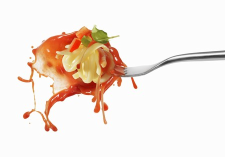 squirted: Pasta and squirted tomato sauce on a fork