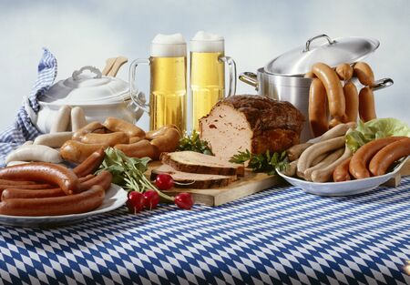steins: Bavarian sausages with beer on tablecloth LANG_EVOIMAGES
