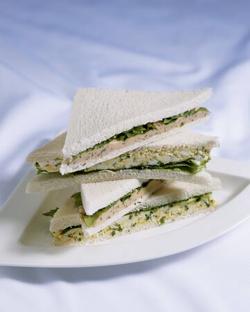 several breads: Egg and lettuce sandwiches and salmon spread sandwiches