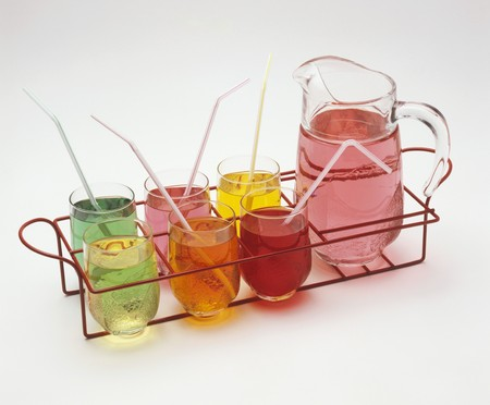 soft drinks: Different coloured soft drinks in glasses and glass jug LANG_EVOIMAGES